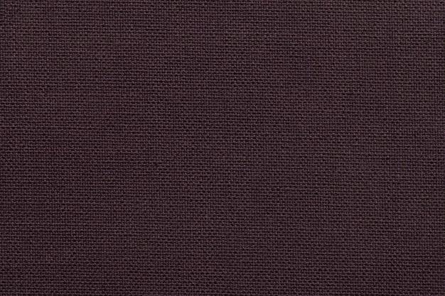 Fond marron foncé d'un matériau textile
