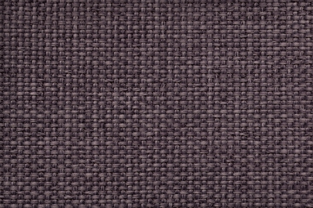 Fond marron avec motif damier tressé, gros plan. texture du tissu de tissage, macro.