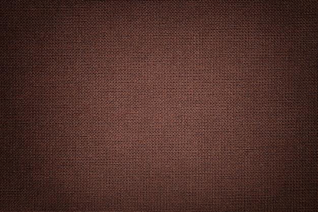 Fond marron à partir d'un matériau textile avec motif en osier, gros plan.