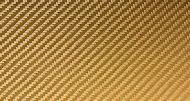 Fond de matière première composite de fibre de carbone d'or
