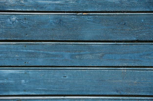 Fond de mer avec de vieilles planches de bois bleu