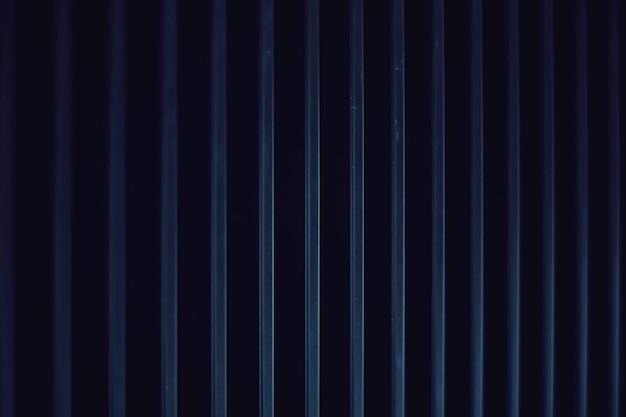Fond en métal bleu foncé comme conception de toile de fond urbaine industrielle et futuriste