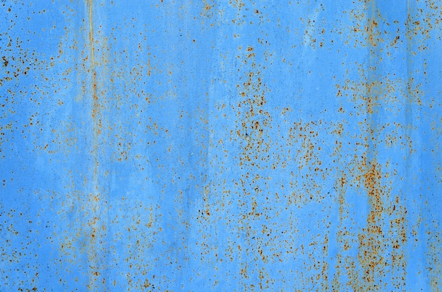 Fond métal rouillé bleu avec texture abstraite.
