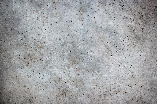 Fond métallique sale avec des éraflures, texture de fer avec des brosses de brosse