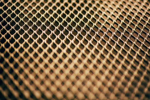 Fond métallique. texture de réseau avec grille de petites cellules. point de mise au point sélective.
