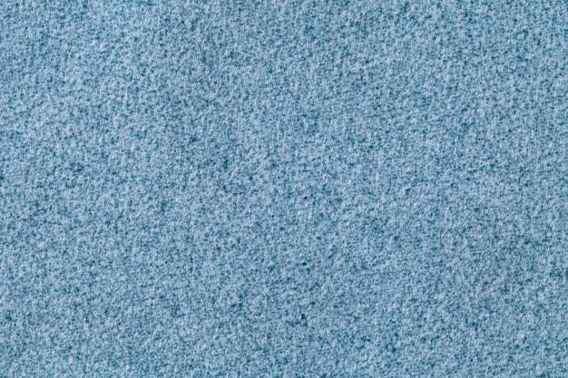 Fond moelleux bleu clair en tissu velours doux. texture de toile de fond textile en laine denim.