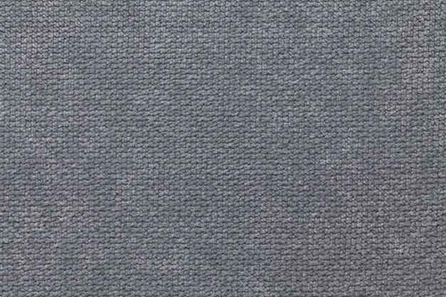 Fond moelleux gris foncé de tissu doux et laineux. texture de gros plan textile