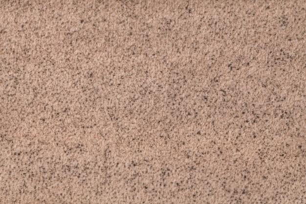 Fond moelleux marron clair de tissu doux et moelleux