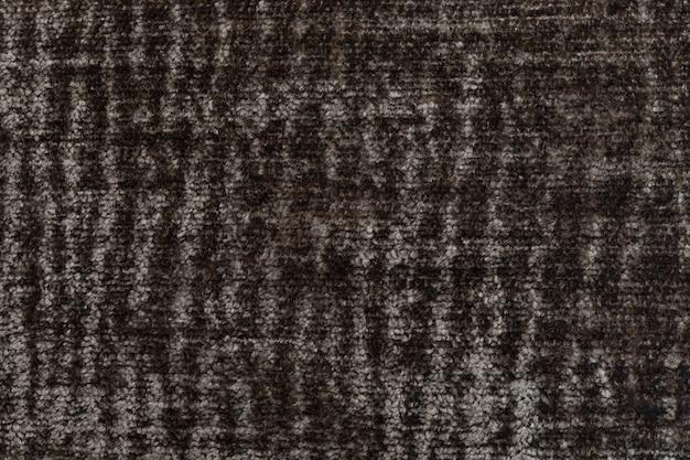 Fond moelleux marron de tissu doux et laineux, texture de textile closeup