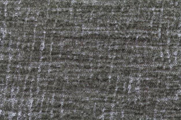 Fond moelleux vert de tissu doux et laineux, texture de textile