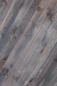 Fond monophonique diagonal de planches de couleur foncée