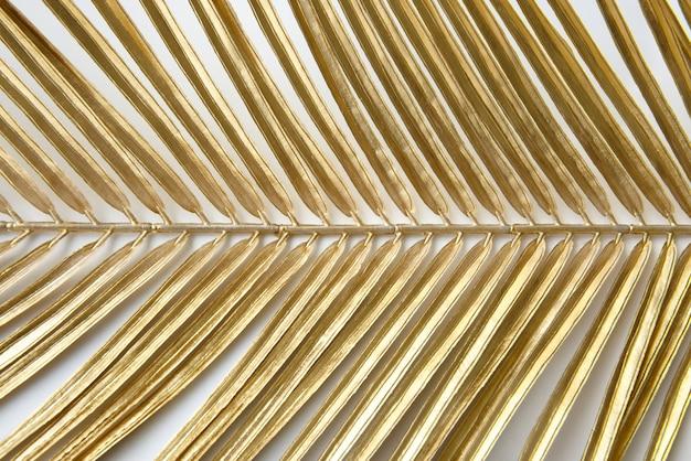 Fond à motifs de feuilles de palmier or