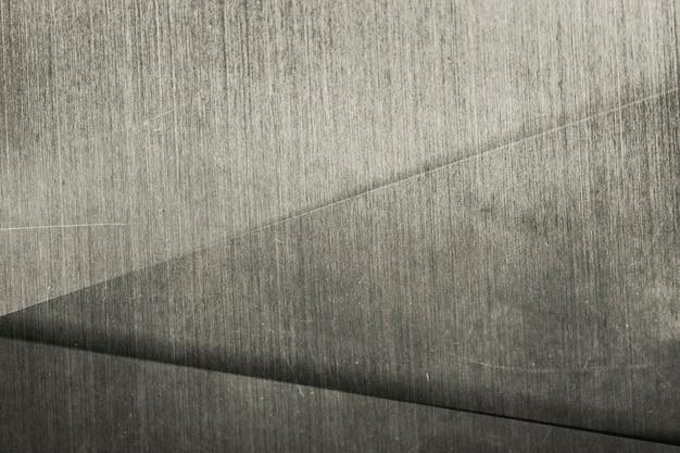 Fond à motifs de triangle métallique blond