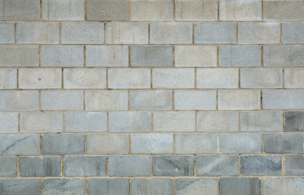 Fond de mur en béton de brique grise. texture des briques ou des blocs de béton pour la construction. pierre et motifs industriels