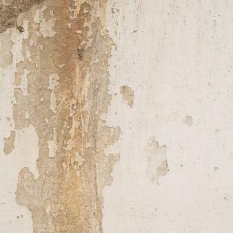 Fond de mur de béton fissuré.