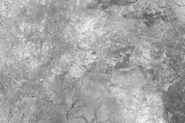 Fond de mur de béton gris.