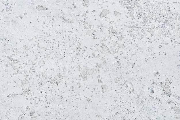 Fond de mur de béton peint peinture écaillée fissurée