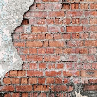 Fond de mur de brique en béton fissuré.