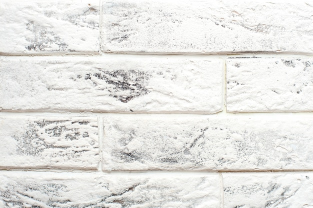 Fond de mur de brique blanche. fermer