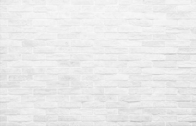 Fond de mur de brique blanche