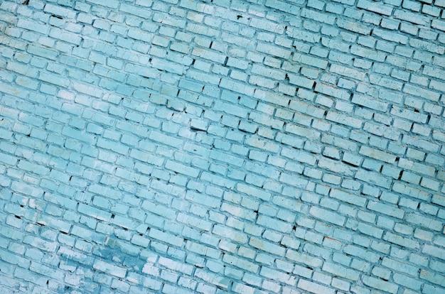 Fond de mur de brique carrée et texture. peint en bleu