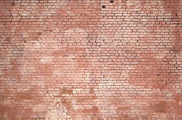Fond de mur de brique carrée et texture. peint en rouge