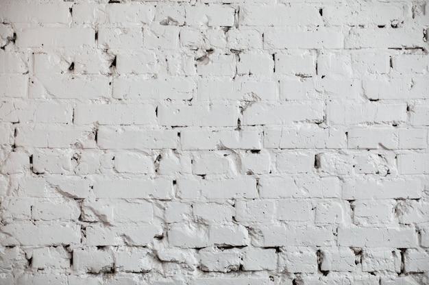 Fond de mur de brique grunge blanc.