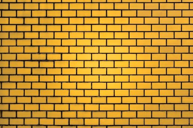 Fond de mur de brique jaune