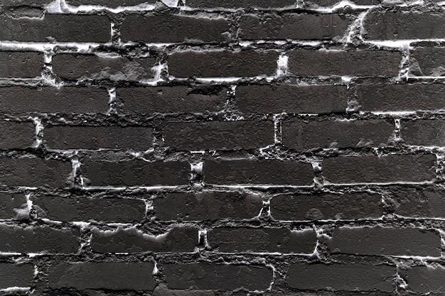 Fond de mur de brique noir et blanc rugueux texture de maçonnerie solide mur de briques horizontale