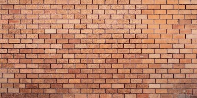 Fond de mur de brique orange.