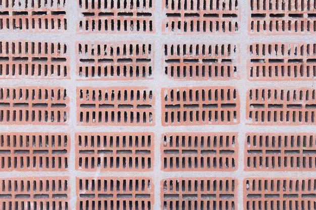 Fond de mur de brique perforé. texture de construction