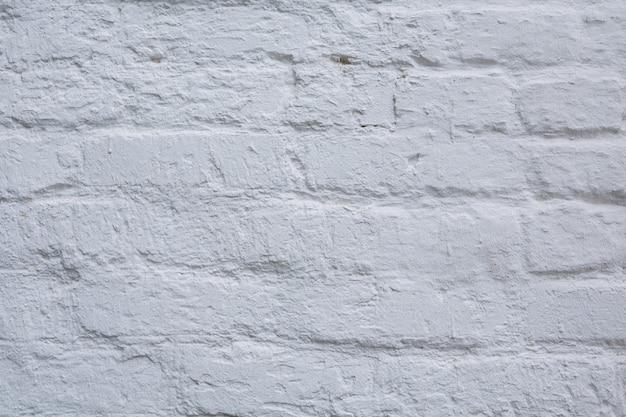 Fond de mur de briques blanches abstraites de texture altérée