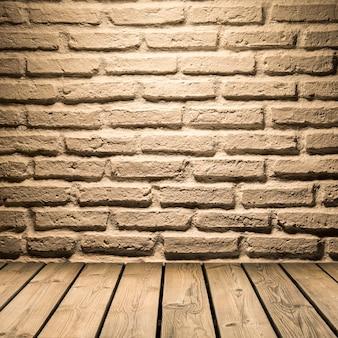 Fond de mur de briques blanches sur plancher en bois