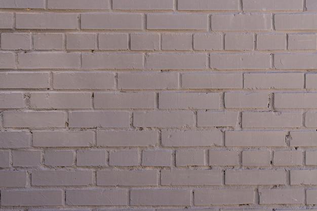 Fond de mur de briques peintes en gris, toile de fond texturée. espace de copie pour les concepteurs.