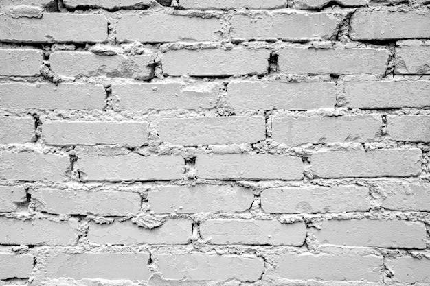 Fond de mur de briques rugueuses mur de briques horizontales en maçonnerie solide gris blanc