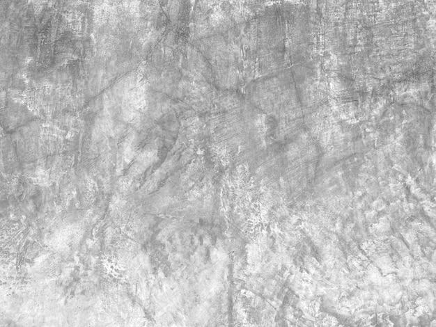 Fond de mur de ciment fissuré vieilli.