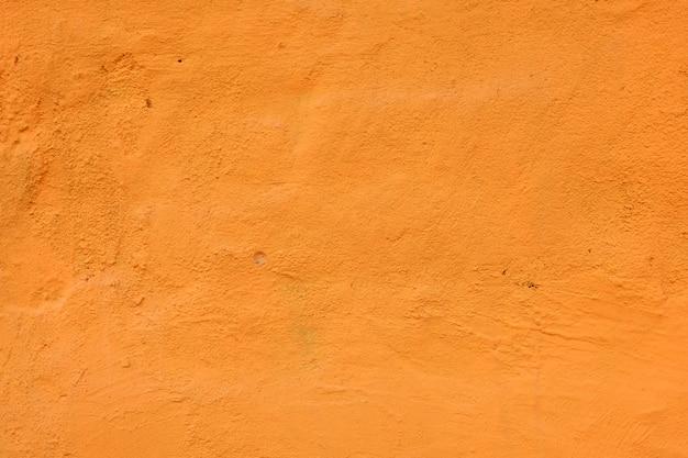 Fond de mur de ciment orange