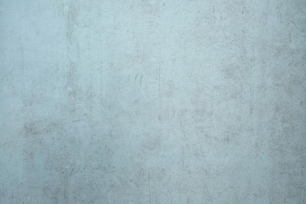 Fond de mur de ciment sale bleu clair.