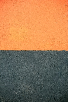 Fond de mur de ciment texture noir et orange