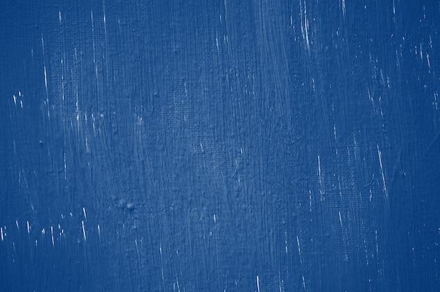 Fond de mur de coloration abstraite de ton bleu classique