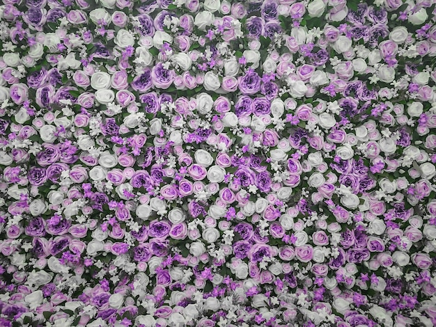 Fond de mur de fleurs artificielles colorées