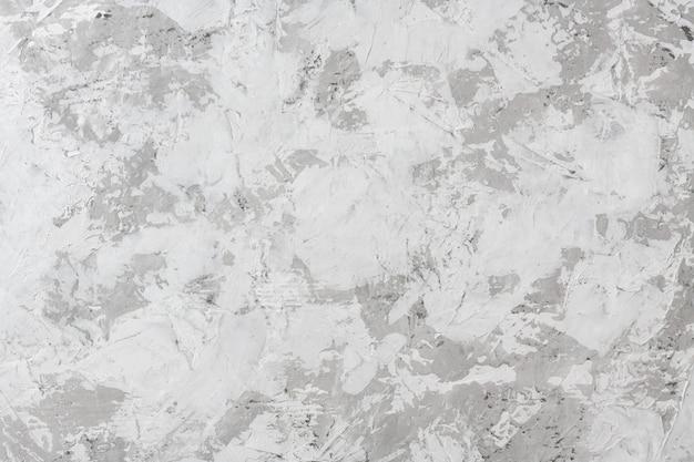 Fond de mur gris grunge rugueux texturé avec imitation de béton en apprêt de surface