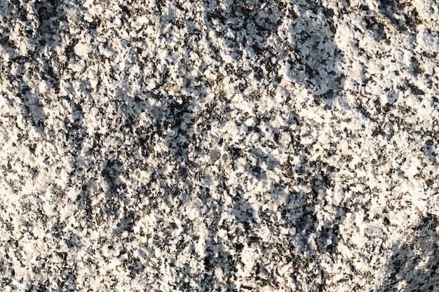 Fond de mur gris avec des points noirs