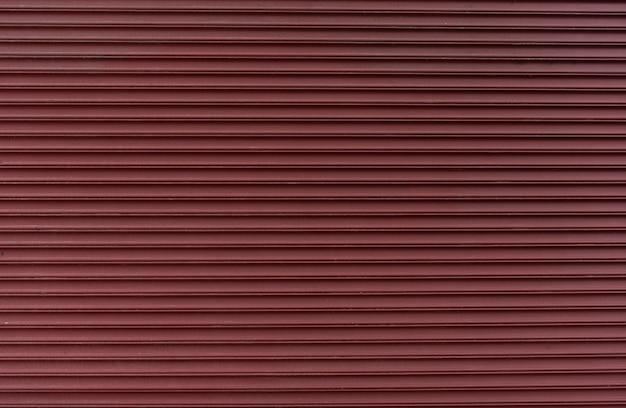 Fond de mur en métal rouge abstrait