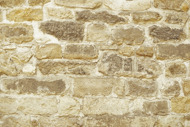 Fond de mur de mosaïque de pierre beige