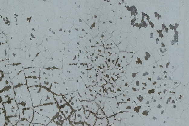 Fond de mur peinture écaillage gâché. notion de grunge