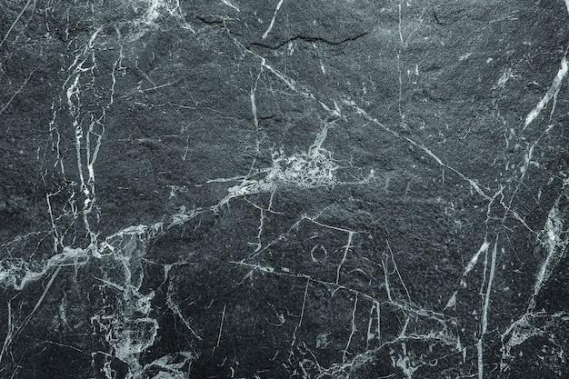 Fond de mur de pierre abstraite rayé marbre rugueux foncé