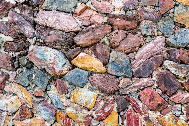 Fond de mur de pierre colorée