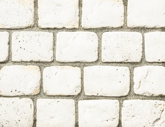 Fond de mur de pierre - composition sans couture de béton et de carreaux pour la construction