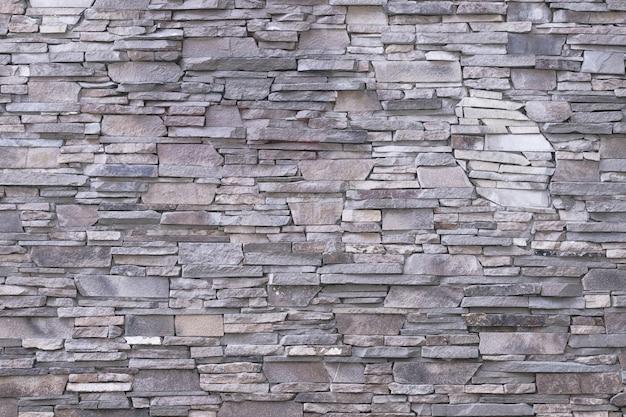 Fond de mur en pierre grise.